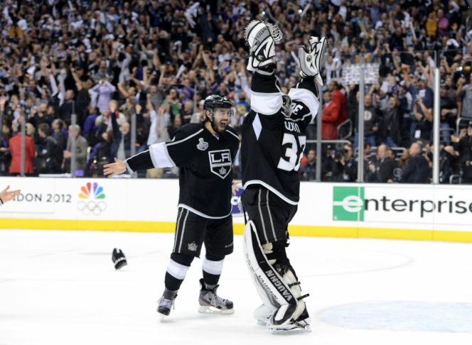 Drew Doughty #8 and Jonathan Quick #32 of the Los Angeles Kings celebrate the Kings 6-1 victory as they win the Stanley Cup in Game Six of the 2012 Stanley Cup Final at Staples Center on June 11, 2012 in Los Angeles, California.