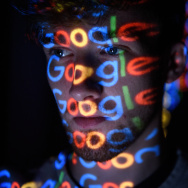 In this photo illustration,  The Google logo is projected onto a man on August 09, 2017 in London, England.