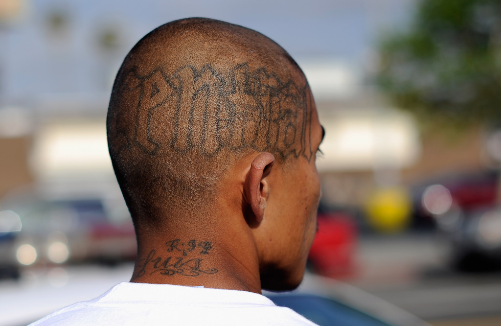 Tattoos are seen on the head of a twenty-year old