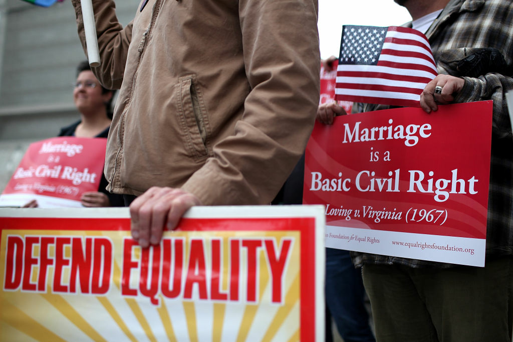 Opponents of Proposition 8, California's anti-gay marriage bill, hold signs outside of the Ninth U.S. Circuit Court of Appeals on February 7, 2012 in San Francisco, California.