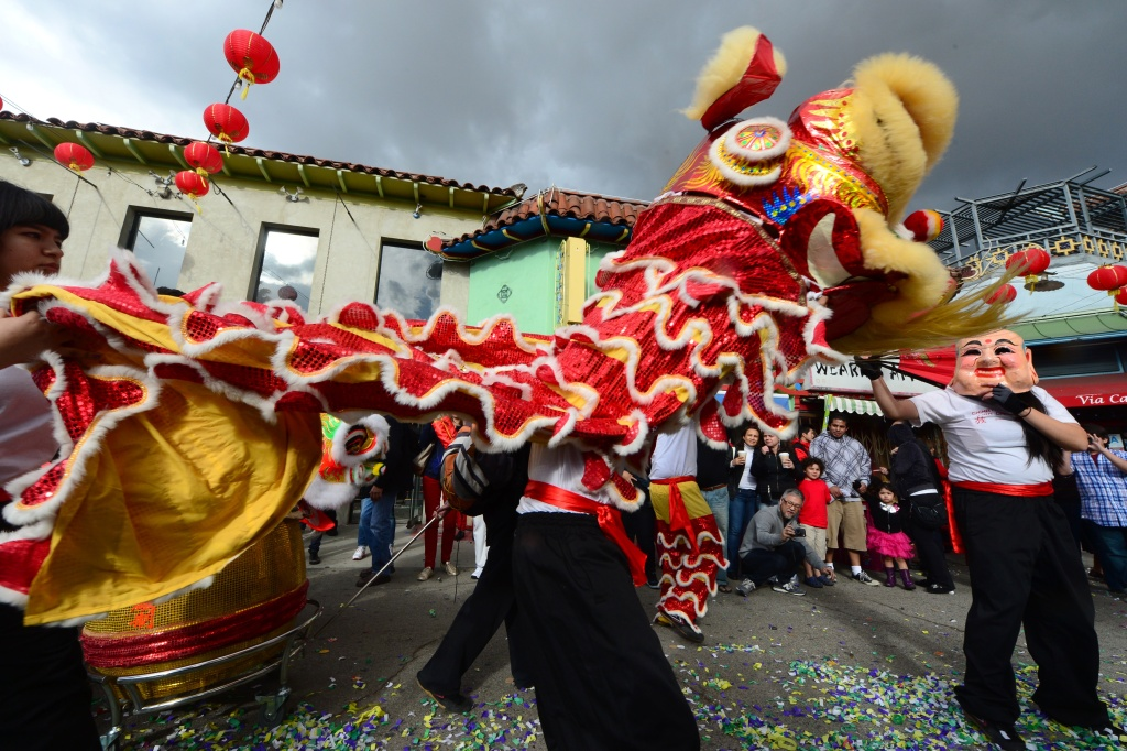 lunar new year celebrations ignite in southern california file people watch as lion dancers snake their way through chinatown in los angeles - Chinese New Year Los Angeles