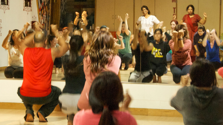 Nakul Dev Mahajan (in red) leads a ladies-only Bollywood class in a one-hour nonstop workout at NDM Bollywood Dance Studios in Artesia, Calif.