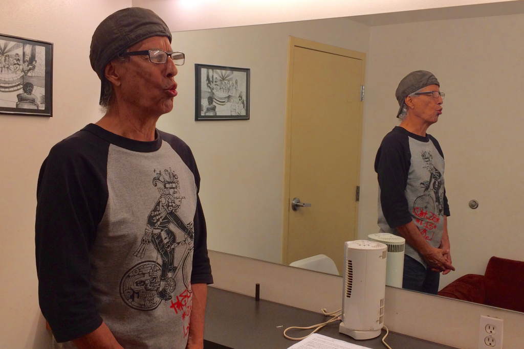 Rubén Guevara warms up his voice before rehearsal at CASA 0101 Theatre in Boyle Heights.