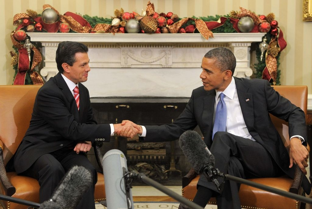US President Barack Obama shakes hands with President-elect Enrique Pena Nieto of Mexico during a bilateral meeting in the Oval Office at the White House in Washington on November 27, 2012. Pena Nieto, a member of the Institutional Revolutionary Party (PRI), takes office on December 1, replacing Felipe Calderon from the conservative National Action Party (PAN), five months after his election victory.