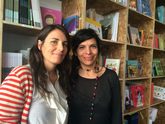 La Librería co-founders, Chiara Arroyo (left) and Celene Navarrete (right) at the opening of their brick and mortar store on West Washington Blvd in Mid-City, Feb 21, 2015. The store sells children literature in Spanish.