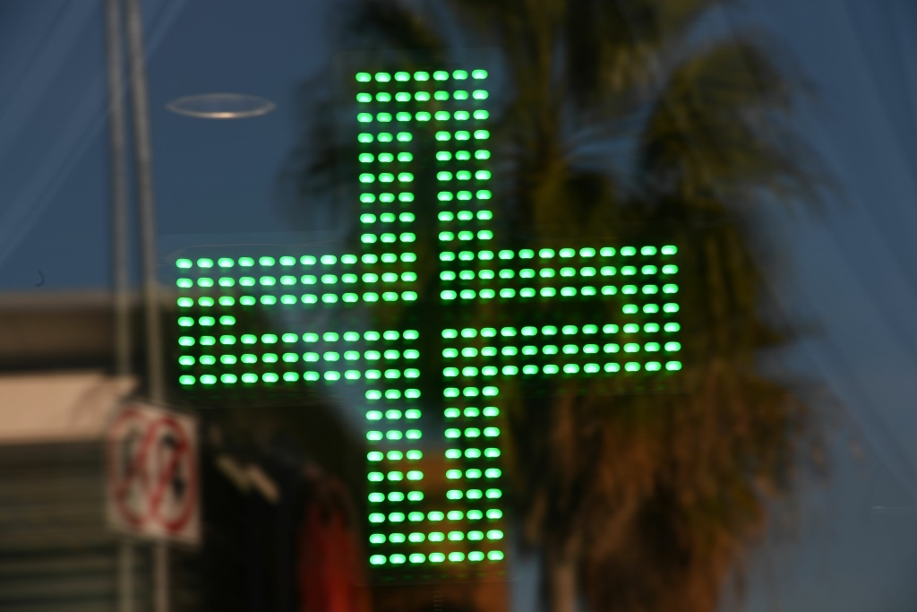 A green cross indicating medical marijuana in the window at the Higher Path dispensary in the Sherman Oaks area of Los Angeles, California, December 27, 2017.