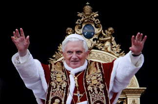 Pope Benedict XVI delivers the 'urbi et orbi' (to the city and the world) blessing from the balcony of the St. Peter' s basilica at the Vatican on December 25, 2009. The pontiff urged wealthy nations on Friday to show 'acceptance and welcome' to migrants fleeing poverty or intolerance at home. The day after an assailant caused the 82-year-old pontiff to fall as he began leading the Christmas Eve mass, he appeared upbeat as he addressed to tens of thousands gathered in St Peter's Square and millions around the world.