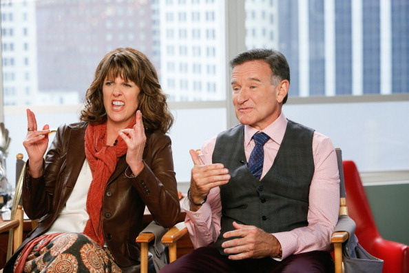 "Pictured (L-R) Pam Dawber and Robin Williams discuss ABC's ""The Crazy Ones."""