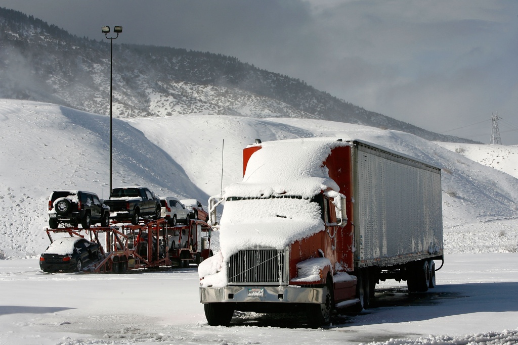 Accumulated snow sits on trucks stranded because Interstate 5, the main route between Los Angeles, to the south, and Sacramento and San Francisco, remains closed due to snow on Jan. 24, 2008, in Frazier Park, California. The National Weather Service says to expect winter conditions near the Grapevine this week.