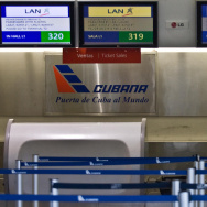 An empty Cuban airline check-in desk. The number of Cubans heading to the United States has soared since the island lifted travel restrictions; now, the U.S. and Cuba could begin the process of improving diplomatic and economic ties. Some Cuban Americans are supportive of the move, but others remain deeply skeptical.