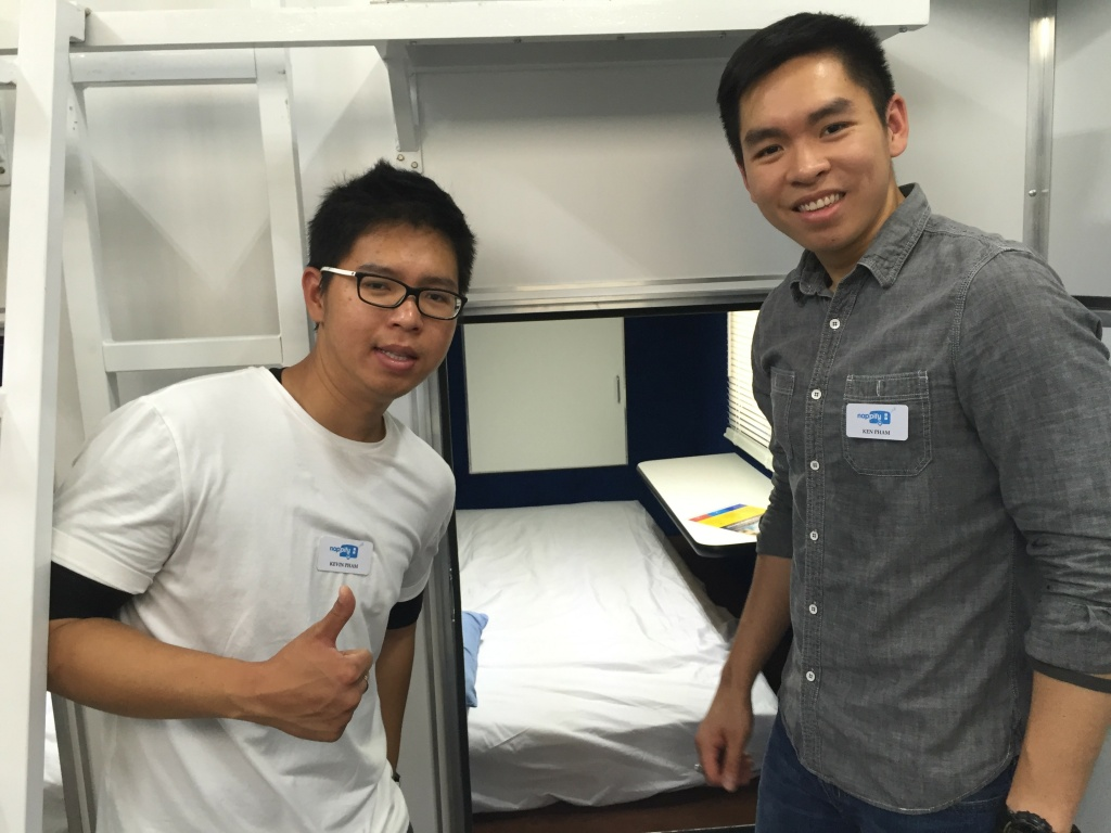 Kevin and Ken Pham hangin' out near their comfy invention: the Nappify pod.
