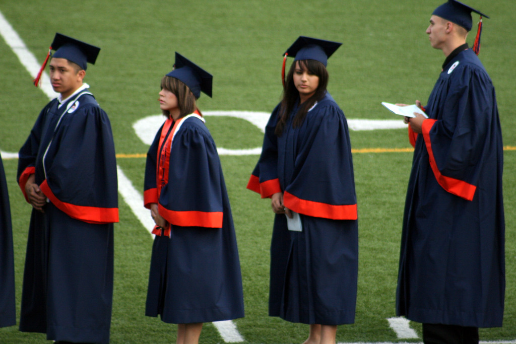 California senators approved a measure that would fix a problem that kept 5,000 seniors in the Class of 2015 from taking the high school exit exam and graduating. On Wednesday, August 26, 2015, Gov. Jerry Brown signed the bill. (Stock photo shows students lined up during graduation ceremony.)