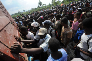 Haitian earthquake victims swarm around a relief truck to collect food in Leogan in 2010 after a massive quake shattered the country.