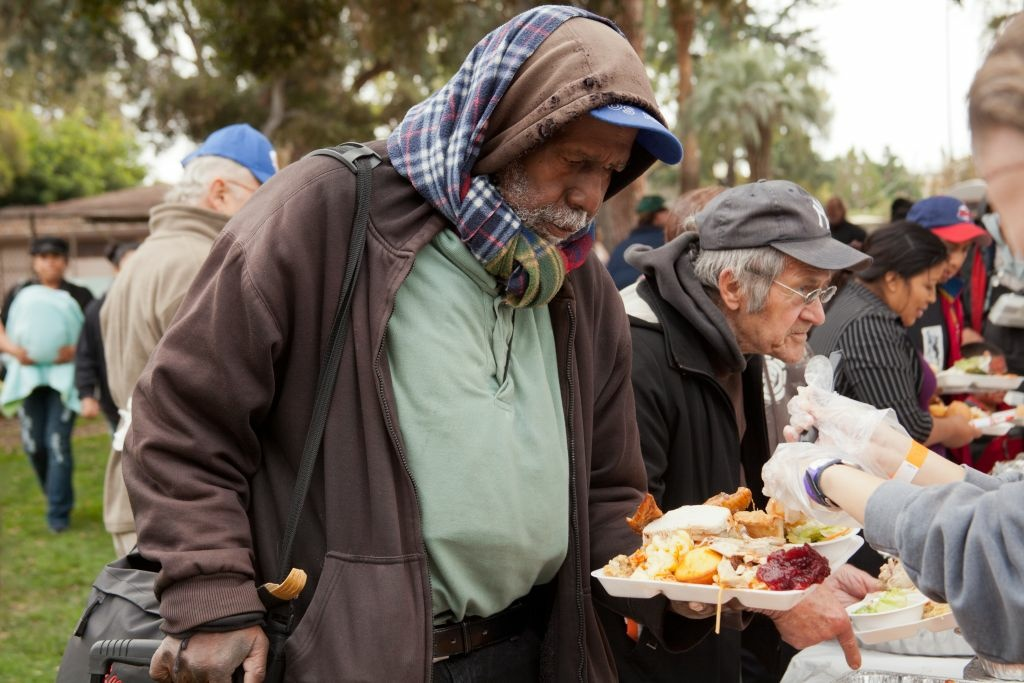 Mark Rice lines up to get a free meal at Union Station Homeless Services' Thanksgiving dinner last year at Central Park in Pasadena.