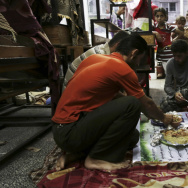 "Members of a Palestinian family break their fast with the ""Iftar"" meal during the holy month of Ramadan at a United Nations school, where hundreds of families have sought refuge after fleeing their homes following fighting between Israeli forces and Hamas."