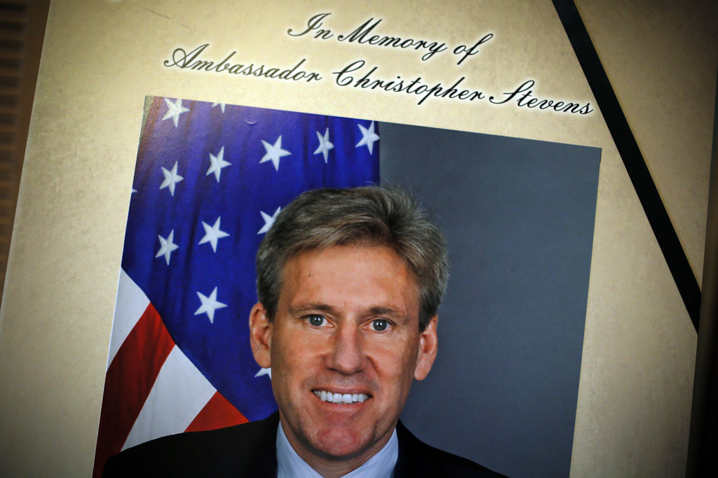 WASHINGTON, DC - SEPTEMBER 14: A portrait of Ambassador J. Christopher Stevens is placed along with a condolence book outside the room of Senate Foreign Relations Committee at the U.S. Capitol September 14, 2012 in Washington, DC. Ambassador Stevens and three other Americans were killed in an attack on the U.S. Consulate in Benghazi, Libya on September 11, 2012.