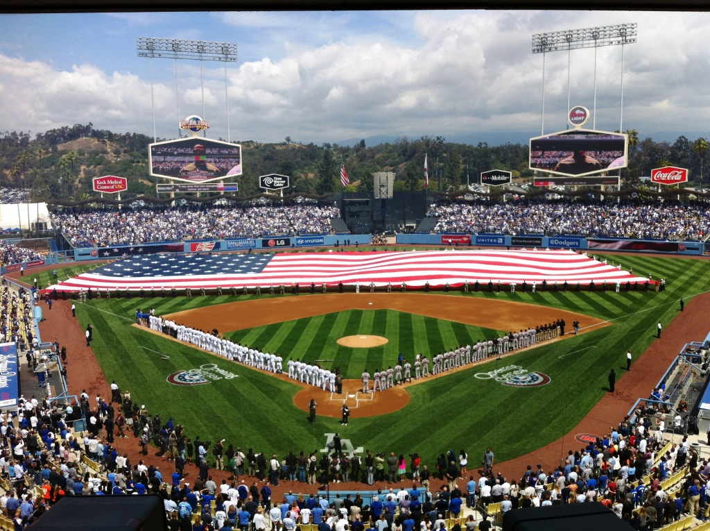 The Stars and Stripes came out as fans sang the National Anthem at Opening Day at Dodger Stadium.