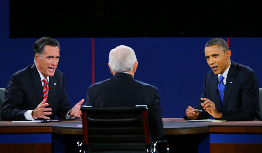 U.S. President Barack Obama (R) debates with Republican presidential candidate Mitt Romney as moderator Bob Schieffer (C) of CBS looks on at the Keith C. and Elaine Johnson Wold Performing Arts Center at Lynn University on October 22, 2012 in Boca Raton, Florida. The focus for the final presidential debate before Election Day on November 6 is foreign policy.