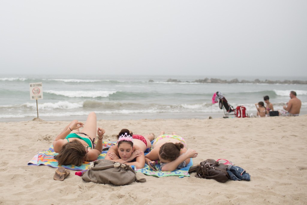 Girls take a nap at Venice Beach on June 27th, 2013.