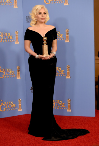 BEVERLY HILLS, CA - JANUARY 10:  Actress/singer Lady Gaga, winner of Best Performance in a Miniseries or Television Film for 'American Horror Story: Hotel,' is Michelle Dalton Tyree's dress and win of the night.(Photo by Kevin Winter/Getty Images)