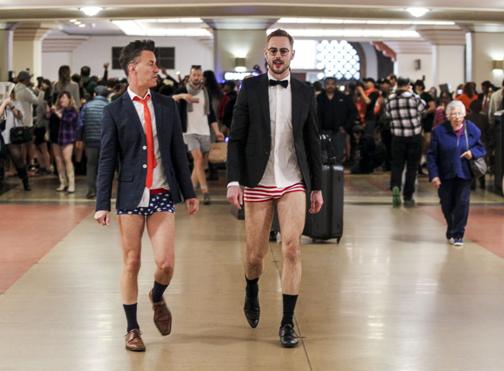 File: Scotland Beaver, left, and Mathew Spencer in the annual 'No Pants Metro Ride' walk in the Union Station on Jan. 10, 2016,  in Los Angeles.