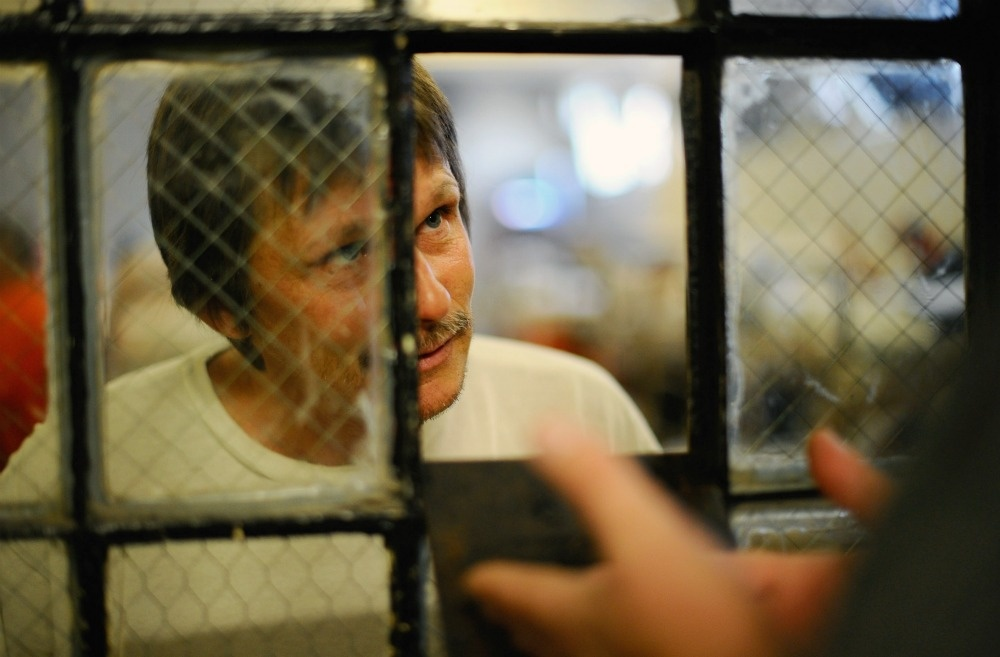 An inmate at Chino State Prison speaks to a parole officer in the overcrowded dayroom of Sycamore Hall that was modified to house prisoners on December 10, 2010 in Chino, California.