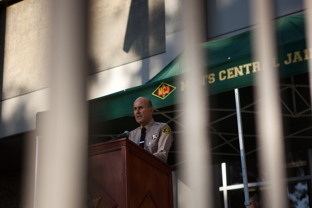 L.A. County Sheriff Lee Baca takes part in a memorial ceremony for a slain deputy at Men's Central Jail in Downtown Los Angeles in this photo from December 2011. Baca is under pressure to adopt jail reforms proposed by a citizens commission. County supervisors want a jail reform
