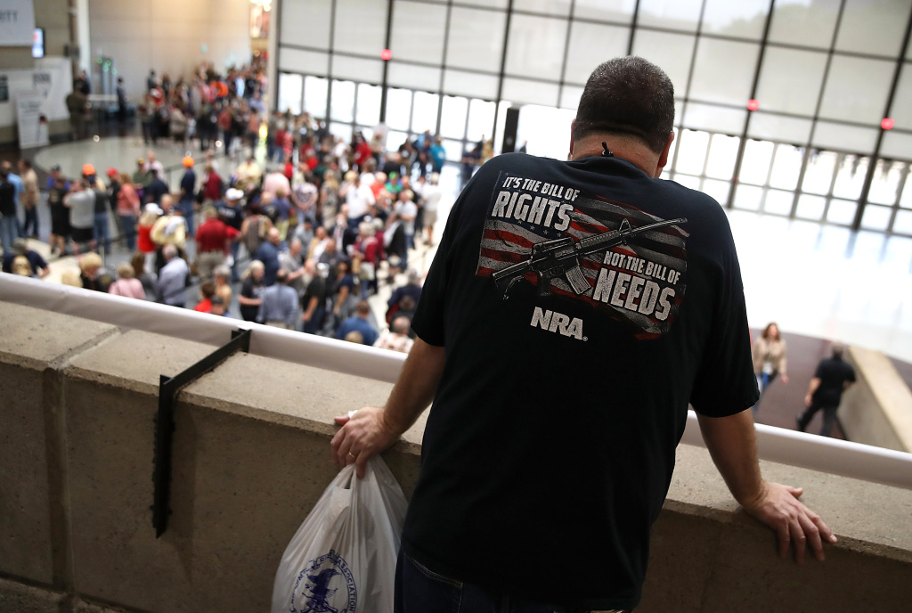 An attendee looks at a line to enter the NRA-ILA Leadership Forum during the NRA Annual Meeting & Exhibits at the Kay Bailey Hutchison Convention Center in Dallas, Texas.