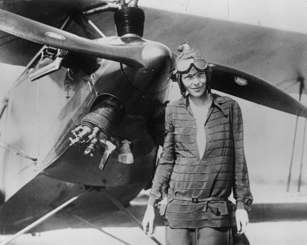 Amelia Earhart stands June 14, 1928 in front of her bi-plane called 'Friendship' in Newfoundland.