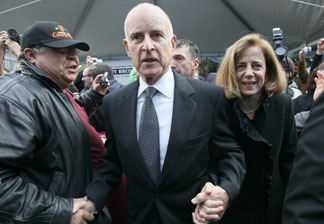 California governor Jerry Brown (C) makes his way through a crowd with his wife Anne Gust Brown (R) during the People's Party after he was sworn in as the 39th governor of California by California on January 3, 2011 in Sacramento, California.