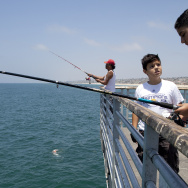 Paul Manasefi, 12, center, talks with John Zein, 13, as they fish on the Hermosa Beach Pier.