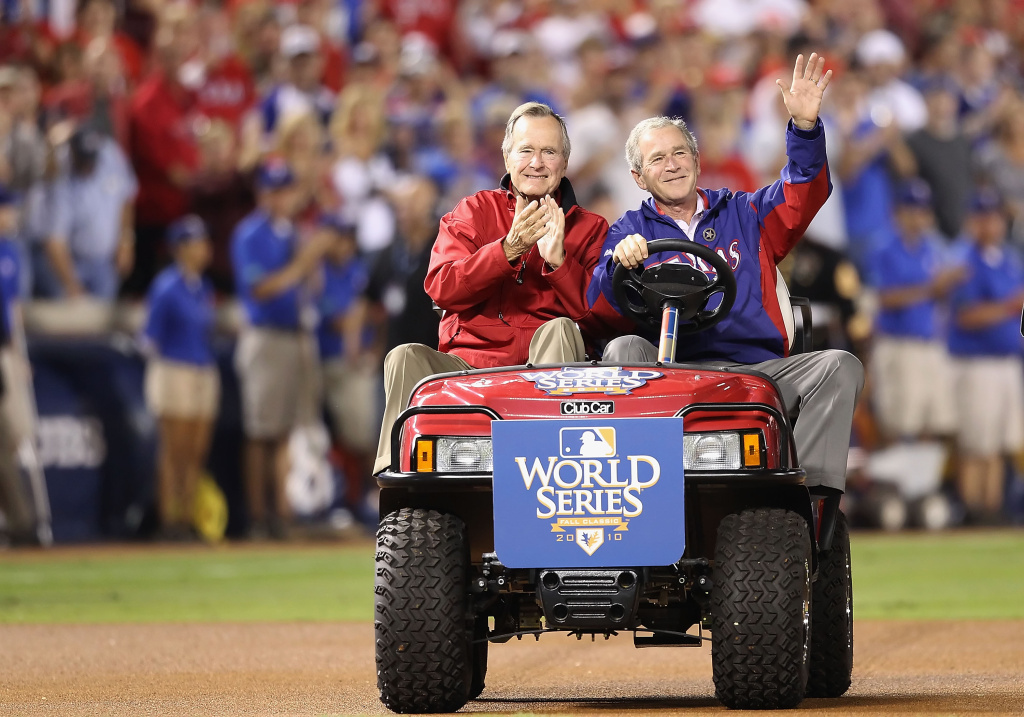 Former President of the United States, George W. Bush, and his father Former President George H.W. Bush wave to the crowd before the Texas Rangers host the San Francisco Giants in Game Four of the 2010 MLB World Series on Oct. 31, 2010 in Arlington, Texas.