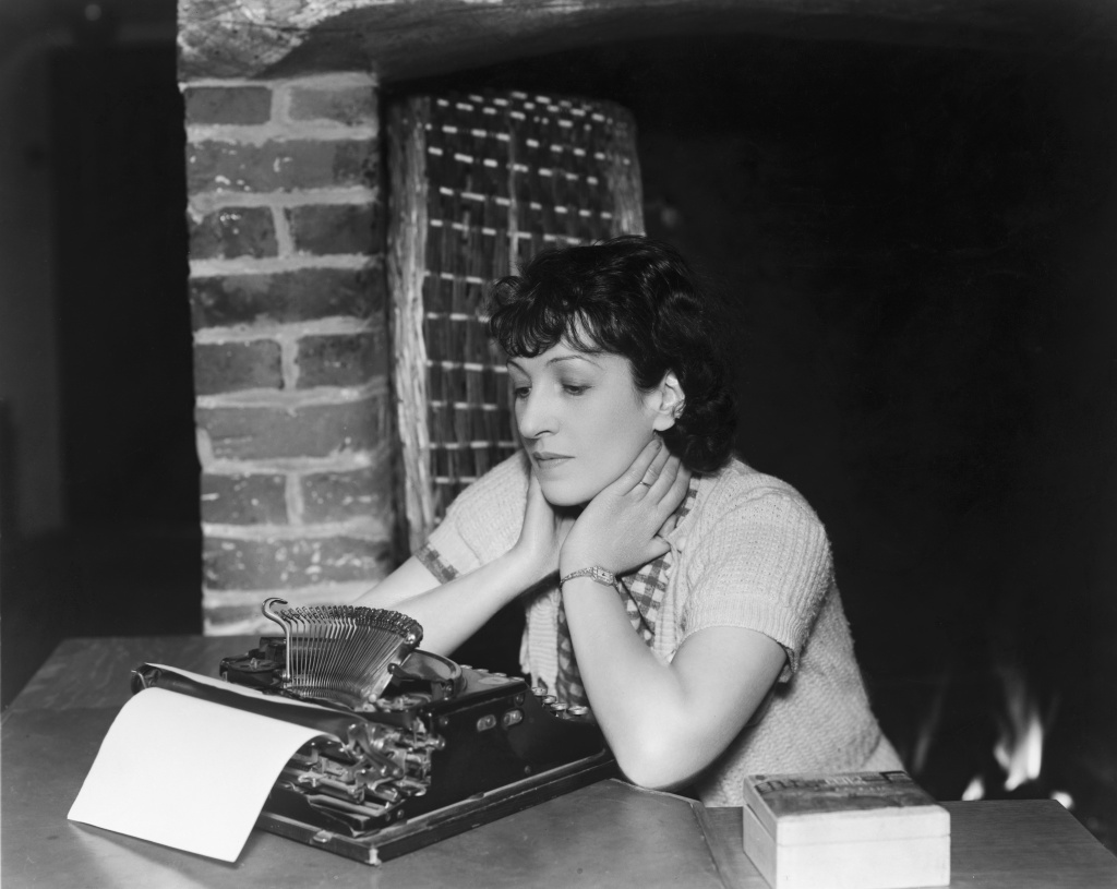 British playwright, novelist, screen writer and children's author Evadne Price (1896 - 1985) waits for inspiration on May 8, 1936.