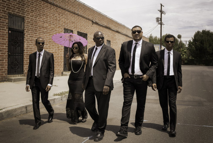 The cast of the improv group The Black Version.