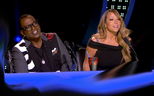 American Idol judges Randy Jackson and Mariah Carey as the top 10 girls performed, Tuesday, March 5, 2013 — with a Coke Zero cup.