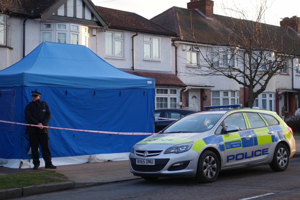 A policeman stands guard outside the house of deceased Russian Nikolai Glushkov in southwest London on March 13, 2018.