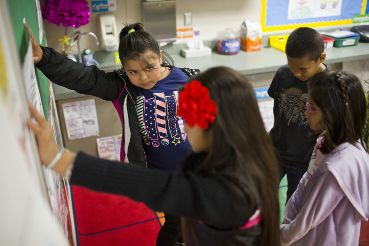 "Fourth-graders Fatima Gomez, left, and Christian de la Luz work as partners to summarize a court case at George Brown Elementary, a dual-language school in San Bernardino, on Monday, May 4, 2015. ""In the dual language program, the pedagogy was a lot of collaborative work and a lot of engagement,"" says Maribel Lopez-Tyus, the school's principal."