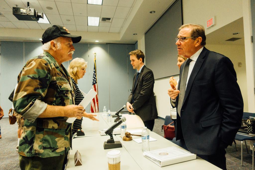Navy veteran Charles Boyd Hanlon (left) speaks to Rep. Neal Dunn (R-FL), the chairman of the House VA Subcommittee on Health.