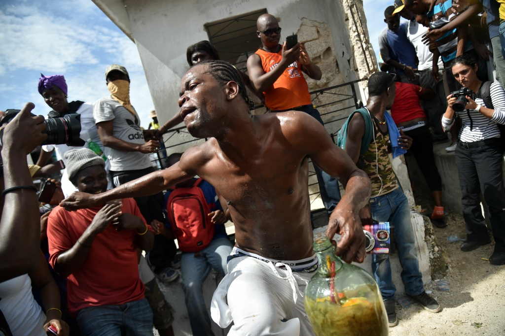 A devotee dances in a trance during a ceremony honoring the Haitian voodoo spirits of Baron Samdi and Gede on the Day of the Dead in the National Cemetery in Port-au-Prince, Haiti on November 1, 2016.