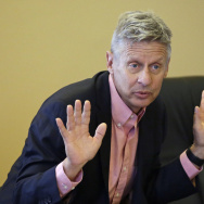 FILE - In this May 18, 2016 file photo, Libertarian presidential candidate, former New Mexico Gov. Gary Johnson speak with legislators at the Utah State Capitol in Salt Lake City. If Hillary Clinton carries Arizona in November, there's a good chance it won't be because the Democratic Party alone has picked off a reliably red state it believes will someday be consistently blue. Instead, she may have Gary Johnson to thank. The Libertarian Party nominee's best chance to impact the 2016 presidential race may well be in Arizona, a traditionally Republican state where he appeals to a group of finicky conservatives who make up part of the party's base.  (AP Photo/Rick Bowmer, File)