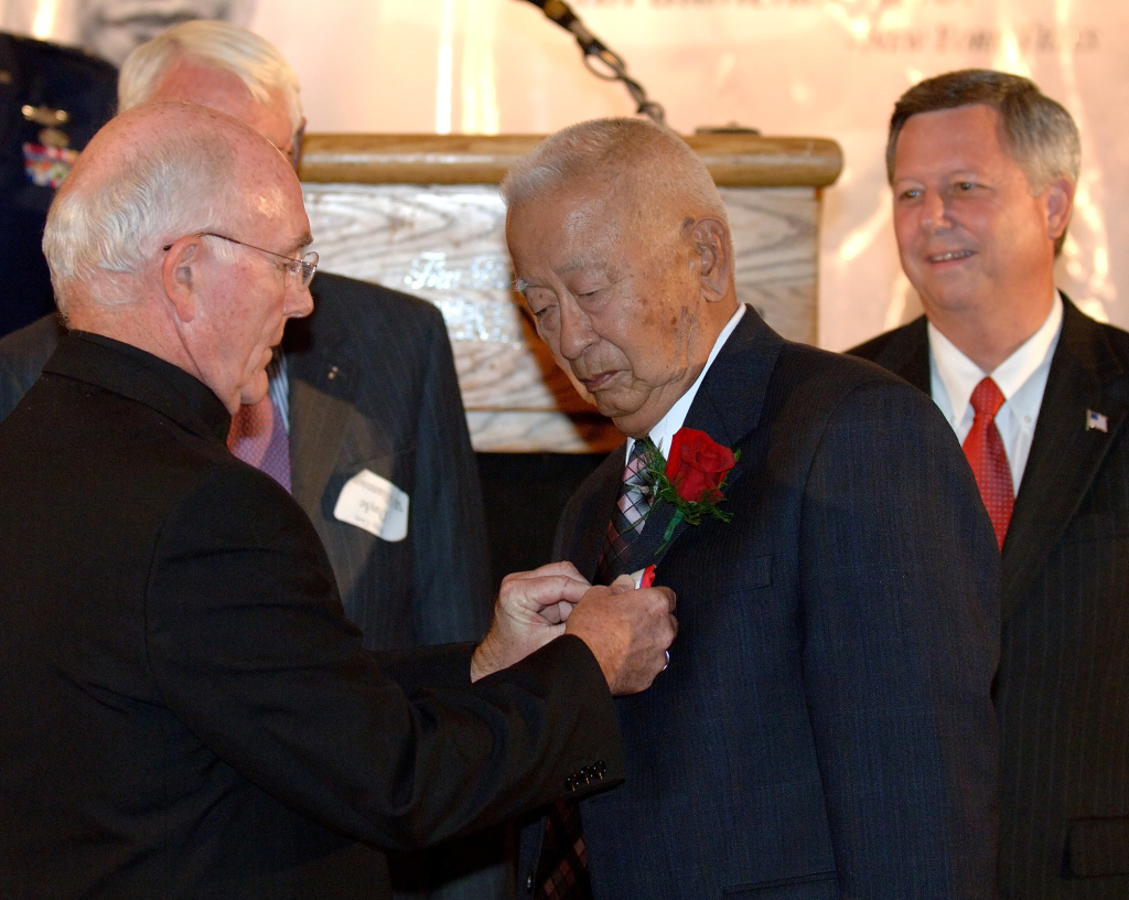Ben Kuroki, seen here being honored for his service in World War II, flew 58 bomber missions over Europe, North Africa and Japan during the war, the only known Japanese American to have done so.