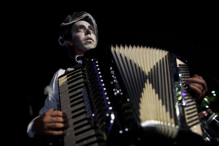 Ulises Rodriguez plays the accordion while warming up for a dress rehearsal of The Long Road Today.
