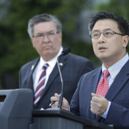 State Treasurer John Chiang (right) at a news conference in Sacramento, Calif., in May. On Wednesday, Chiang announced he is suspending major parts of the state's business relationship with Wells Fargo because of a scandal involving unauthorized customer accounts.