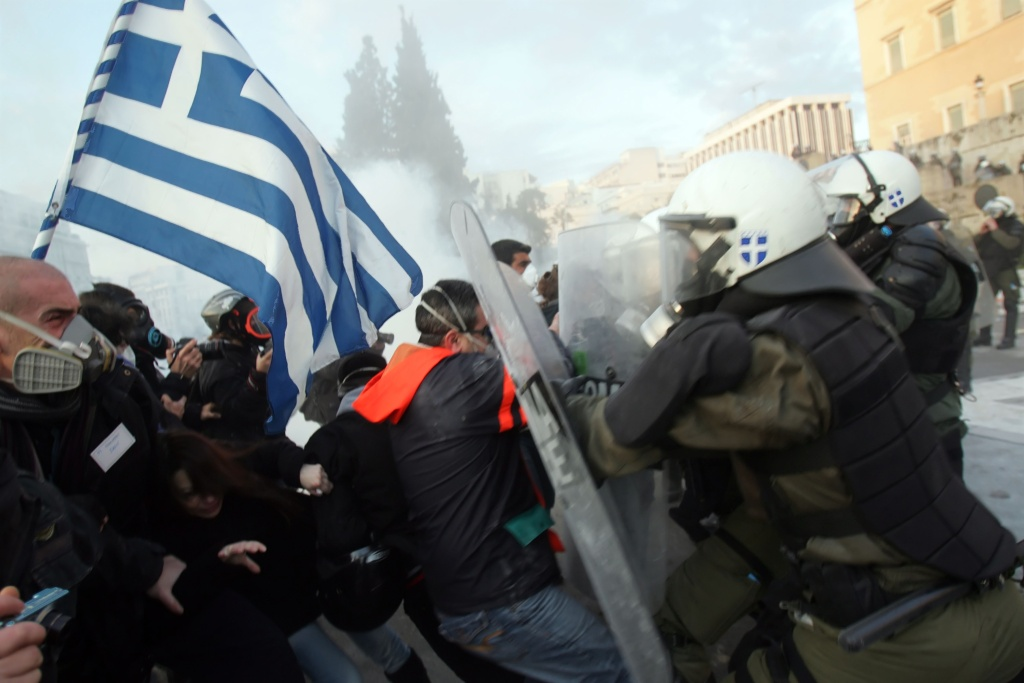 People clash with police in the streets during a demonstration against the new austerity measures on February 12, 2012 in Athens, Greece.