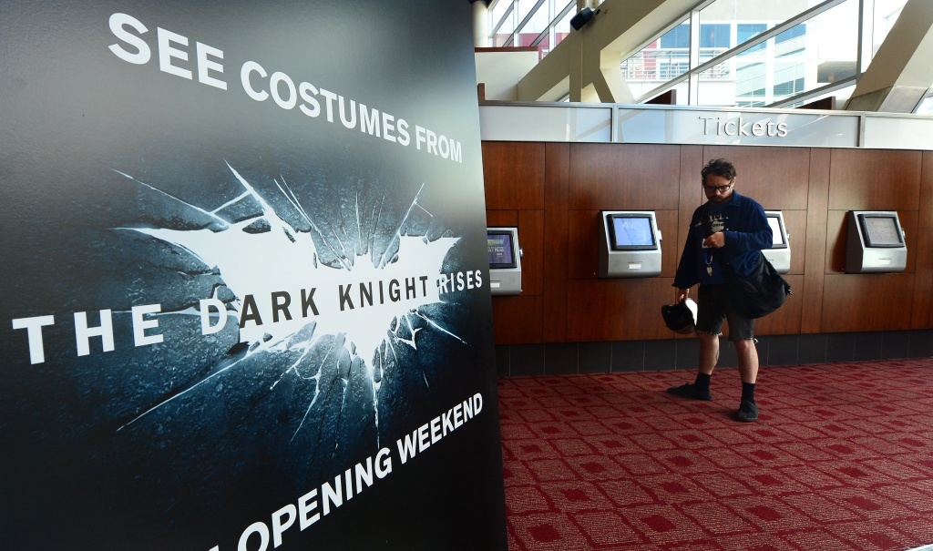 A man purchases his ticket for the latest Batman movie in Hollywood, on July 20, 2012 in California.