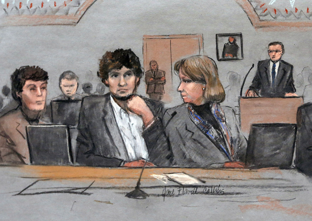 In this courtroom sketch, Dzhokhar Tsarnaev, center, is depicted between defense attorneys Miriam Conrad, left, and Judy Clarke, right, during his federal death penalty trial in this Thursday, March 5, 2015 file photo. The 21-year-old college student, who was previously sentenced to death, broke two years of public silence on Wednesday, June 24, 2015, to apologize to his victims.