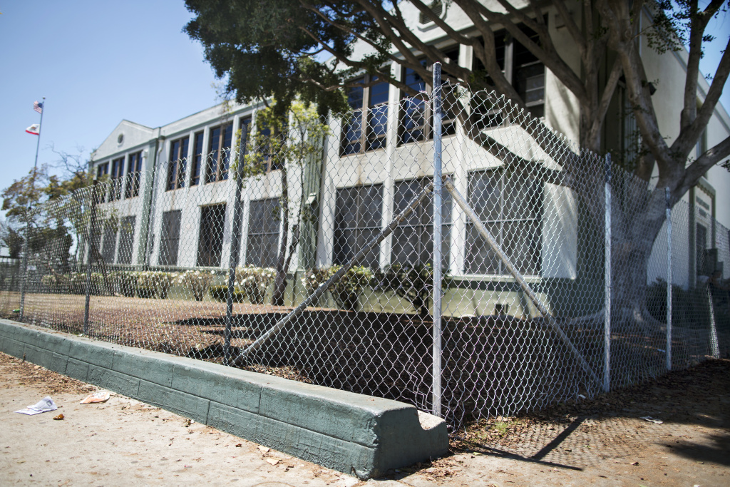 A newly installed chain-link fence surrounds lead-contaminated soil at Lorena Street Elementary School in Boyle Heights.