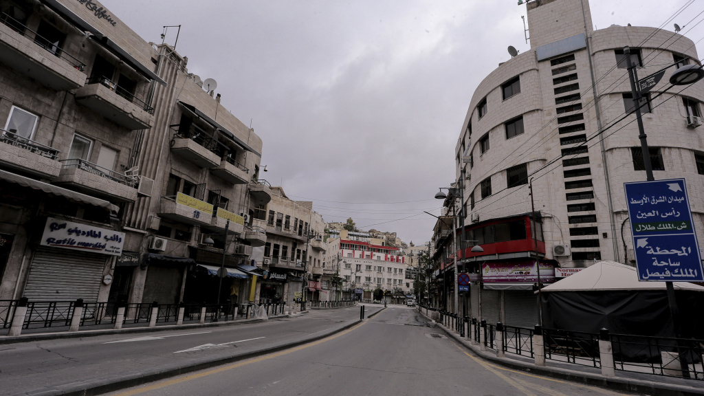 The streets of Jordan's capital of Amman are seen empty after the start of a nationwide curfew on Saturday amid concerns over the coronavirus pandemic.