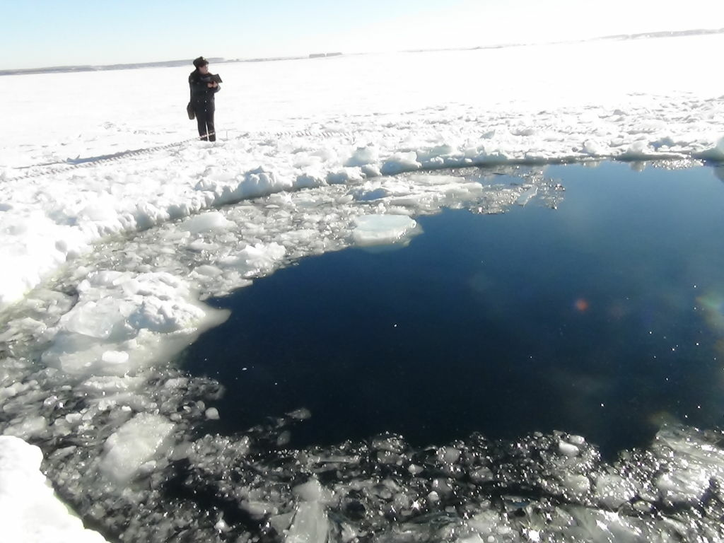 A circular hole in the ice of Chebarkul Lake, where the Chelyabinsk meteor reportedly struck on Feb. 15.