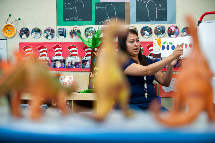 Teacher Lawana teaches preschoolers Marissa Arellano, left, and Andrea Castaneda how to snap their fingers during the afternoon session at Options Head Start in Monrovia on Thursday, May 16.